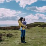 Mother holding baby on Dartmoor - Plymouth Family Photographer - Perfect Story Photography