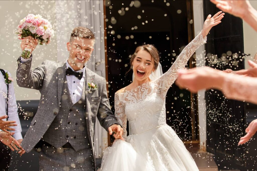 Couple exit church with confetti - Plymouth Wedding Photographer - Perfect Story Photography