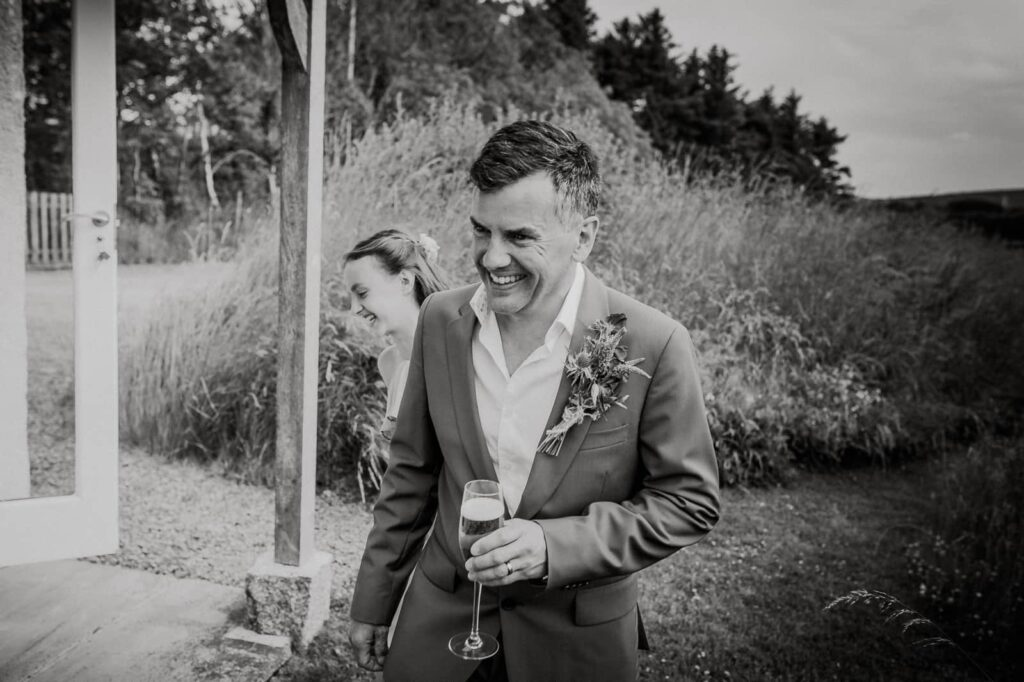 Smiles and laughter by Cornwall Wedding Photographer